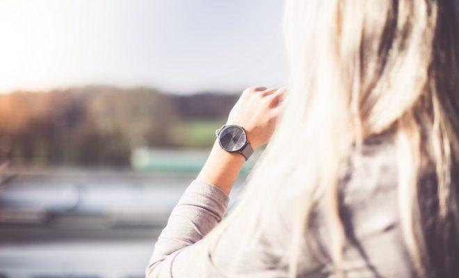 young-woman-with-gray-fashion-watches-enjoying-views-picjumbo-com